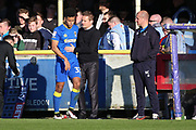 AFC Wimbledon manager Neal Ardley talking to AFC Wimbledon striker Lyle Taylor (33) during the EFL Sky Bet League 1 match between AFC Wimbledon and Southend United at the Cherry Red Records Stadium, Kingston, England on 25 March 2017. Photo by Matthew Redman.