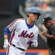NEW YORK, NEW YORK - July 03: Wilmer Flores #4 of the New York Mets rounds the bases after hitting a home run during the Chicago Cubs Vs New York Mets regular season MLB game at Citi Field on July 03, 2016 in New York City. (Photo by Tim Clayton/Corbis via Getty Images)