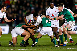 Rusiate Tuima of England U20 is tackled by itJack Crowley of Ireland U20 - Rogan/JMP - 21/02/2020 - Franklin's Gardens - Northampton, England - England U20 v Ireland U20 - Under 20 Six Nations.