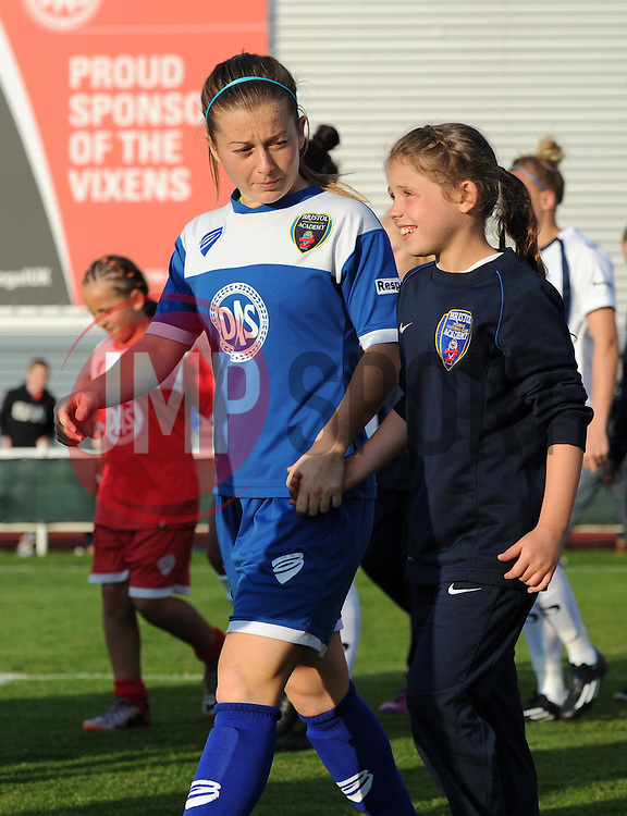 Christie Murray of Bristol Academy Women and her mascot walk on to the pitch at Stoke Gifford Stadium - Mandatory by-line: Paul Knight/JMP - Mobile: 07966 386802 - 05/09/2015 -  FOOTBALL - Stoke Gifford Stadium - Bristol, England -  Bristol Academy Women v Birmingham City Ladies FC - FA Women's Super League