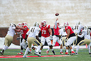 DALLAS, TX - DECEMBER 7: Neal Burcham #12 of the SMU Mustangs drops back to pass against the Central Florida Knights on December 7, 2013 at Gerald J. Ford Stadium in Dallas, Texas.  (Photo by Cooper Neill) *** Local Caption *** Neal Burcham