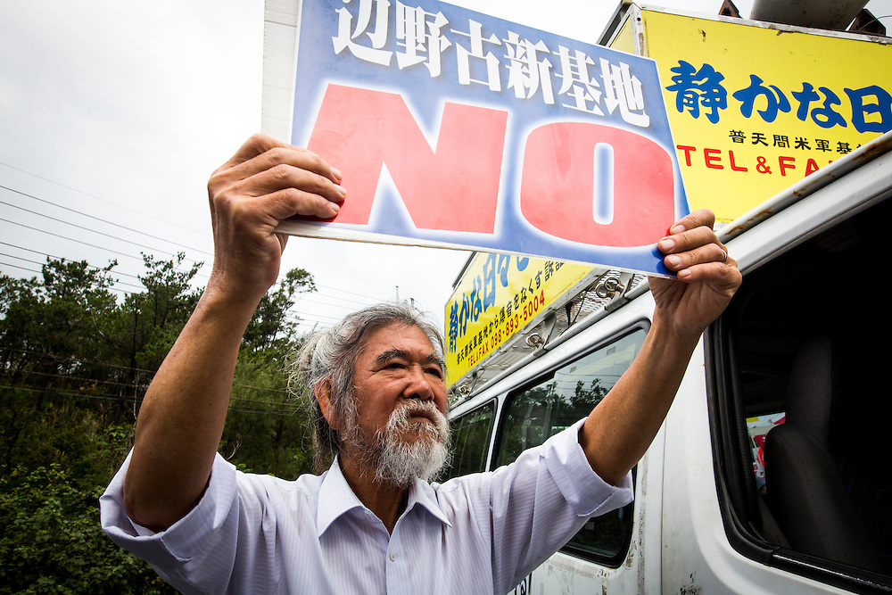 OKINAWA, JAPAN - JANUARY 19 : Anti U.S. Base protesters shout with their placards to protest against the relocation of the new U.S Marine Airbase construction in Oura Bay, Camp Schwab, Henoko, Nago, Okinawa, Japan on Janaury 19, 2017. The scheduled reclamation area for new the construction totals 160 hectares and will include 2 runways. Construction of the new base will require 21 million cubic meters of soil, enough to fill the Okinawa Prefectural Office 70 times, 17 million tons of which will be hauled in from Kyushu and Shikoku. (Photo by Richard Atrero de Guzman/NURPhoto)