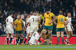 England Flanker Chris Robshaw (capt) hugs Flanker Tom Wood as Australia players look dejected after England beat Australia 26-17 - Photo mandatory by-line: Rogan Thomson/JMP - 07966 386802 - 29/11/2014 - SPORT - RUGBY UNION - London, England - Twickenham Stadium - England v Australia - QBE Autumn Internationals.