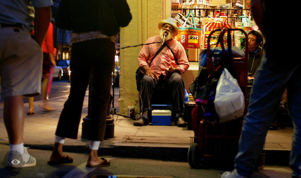 Street musicians continue to entertain as tourism returns to New Orleans and the virtually undamaged French Quarter. High water from Hurricane Katrina avoided the historic district while devastating other parts of the city.