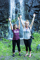 Young women smiling in front of waterfall near Leavenworth, Washington