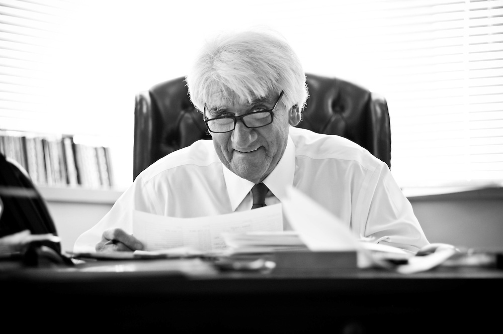 Thomas P. O'Neill at his desk in the offices of O'Neill and Associates near Boston's Government Center.