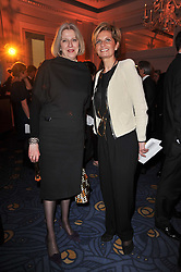 Left to right, the Home Secretary THERESA MAY MP and SABINA BELLI at the 38th Veuve Clicquot Business Woman Award held at Claridge's, Brook Street, London W1 on 28th March 2011.
