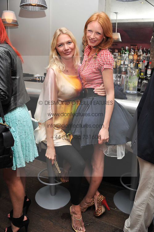 Left to right, JODIE KIDD and OLIVIA INGE at a pool party to celebrate the UK launch of the Omega Ladymatic Collection held at the Haymarket Hotel, Haymarket, London on 16th June 2011.