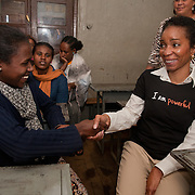 Meseret Mekoni, 18,  talks with CARE President Helene Gayle, at Biruh Tesfa, in Addis Ababa. Biruh Tesfa means bright future in Amharic, and is a program for urban adolescent girls at risk of exploitation and abuse. For many girls, going to Biruh Tesfa is their only hope of an education and a respite from their domestic work. ..The program promotes functional literacy, life skills, livelihoods skills, and HIV/reproductive health education through girls' clubs led by adult female mentors. The girls' clubs are held in meeting spaces donated by the kebele (local administration).