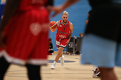 Jordan Nicholls of Bristol Flyers dribbles with the ball - Photo mandatory by-line: Arron Gent/JMP - 28/04/2019 - BASKETBALL - Surrey Sports Park - Guildford, England - Surrey Scorchers v Bristol Flyers - British Basketball League Championship