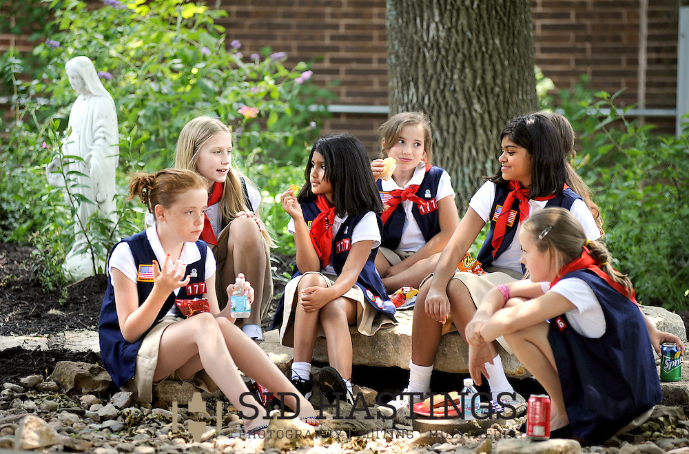 9 JUNE 2012 -- COTTLEVILLE, Mo. -- Members of American Heritage Girls Troop 1776 visit while having lunch after their year-end meeting at St. Joseph Parish in Cottleville, Mo. Saturday, June 9, 2012. Photo © copyright 2012 Sid Hastings.