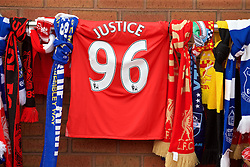 "LIVERPOOL, ENGLAND - Thursday, May 5, 2016: A Liverpool shirt with the words ""Justice 96"" on the back tied with scarves at Liverpool's temporary memorial to the 96 victims of the Hillsborough disaster, pictured ahead of the UEFA Europa League Semi-Final 2nd Leg match against Villarreal at Anfield. (Pic by David Rawcliffe/Propaganda)"