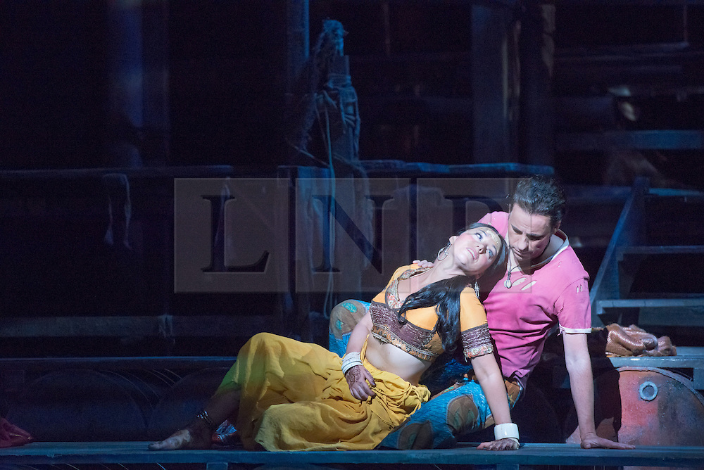 © Licensed to London News Pictures. 13/06/2014. London, UK. English National Opera perform Bizet's The Pearl Fishers at the London Coliseum. Picture features: John Tesslier as Nadir and Sophie Bevan as Leila. Photo credit : Tony Nandi/LNP