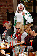 "Jerry Francis as Marshal Herdsman (standing) during Mayhem & Mystery's production of ""Christmas Pageant Crisis"" at the Spaghetti Warehouse in downtown Dayton, Monday, November 12, 2012."