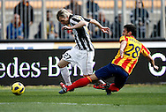 ITALY, Lecce : Krazic J Brivio L.during the Serie A match between Lecce and Juventus at Stadio Via del Mare in Lecce on February 20, 2011. .AFP PHOTO / GIOVANNI MARINO