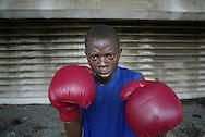 Men from slum areas practice boxing in lagos