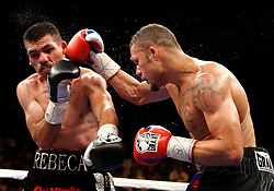 May 30, 2009; Hollywood, FL, USA; Alfredo Angulo and Kermit Cintron trade punches during their 12 round bout at the Hard Rock Live at the Seminole Hard Rock Hotel and Casino in Hollywood, FL.