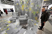 HONG KONG - MARCH 13: A visitor reacts to installation 'Wonderful plan' by Zhou Jie on display in art fair Art Basel on its preview day on March 13, 2015 in Hong Kong, Hong Kong.  (Photo by Lucas Schifres/Getty Images)