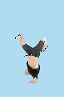 Break dancer on one arm over blue background