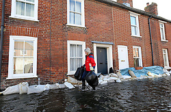 A resident rescues possessions from her flooded home in the village of Bridge, Kent , United Kingdom. Sunday, 9th February 2014. Picture by Stephen Lock / i-Images