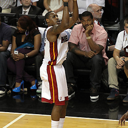 Jun 19, 2012; Miami, FL, USA; Miami Heat point guard Mario Chalmers (15) shoots a three point shot against the Oklahoma City Thunder during the first quarter in game four in the 2012 NBA Finals at the American Airlines Arena. Mandatory Credit: Derick E. Hingle-US PRESSWIRE