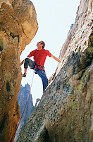 Male rock climber between two rock faces Smith Rock State Park Oregon USA