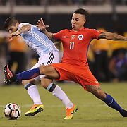EAST RUTHERFORD, NEW JERSEY - JUNE 26:  Ever Banega #19 of Argentina is challenged by Eduardo Vargas #11 of Chile during the Argentina Vs Chile Final match of the Copa America Centenario USA 2016 Tournament at MetLife Stadium on June 26, 2016 in East Rutherford, New Jersey. (Photo by Tim Clayton/Corbis via Getty Images)