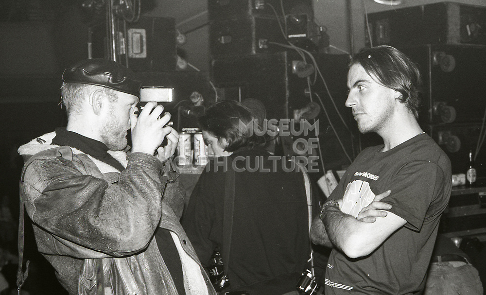 A photographer takes pictures of a Happy Mondays fan at the Free Trade Hall in Manchester, 1989.