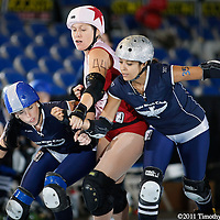Denver plays Sacred City on the second day of the Women Flat Track Derby Association Western Regions, in the Memorial Coliseum, in Portland Ore., on Saturday Sept. 24, 2011. Denver defeated Sacred City on the second day of the Women Flat Track Derby Association Western Regions, in the Memorial Coliseum, in Portland Ore., on Saturday Sept. 24, 2011.