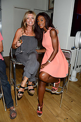 Left to right, TINA HOBLEY and PHOEBE VELA at an Evening with Notting Hill Guitars held at 167 Westbourne Grove, London W11 on 4th September 2013.
