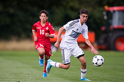 WREXHAM, WALES - Thursday, August 15, 2019: Cyprus' Angelos Neophytou and Malta's Matthias Said during the UEFA Under-15's Development Tournament match between Cyprus and Malta at Colliers Park. (Pic by Paul Greenwood/Propaganda)