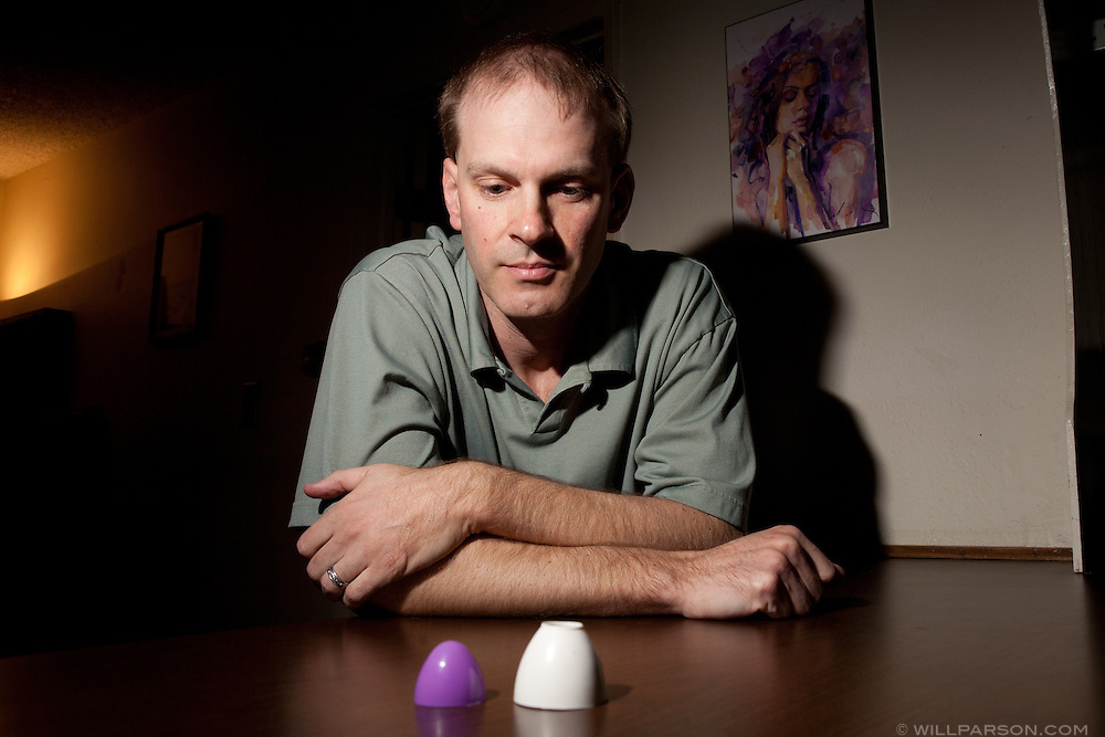 Matthew Hess poses with an (unused) foreskin restoration device similar to one he uses. Hess has submitted bills to state and national assemblies proposing a revision to genital mutilation bills to make them gender neutral.