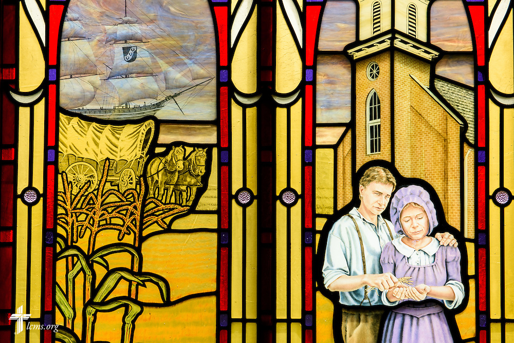 Stained glass at St. Paul Evangelical Lutheran Church in Columbus, Ind., depicts the ship carrying German immigrants to the United States and settling in the rural area of Columbus, photographed Sunday, April 10, 2016. The original church building also pictured is now La Iglesia Luterana San Pablo. LCMS Communications/Erik M. Lunsford