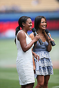 LOS ANGELES, CA - JUNE 30:  Field announcers (L-R) Courtney Jones and Angela Sun address the fans on the public address system during the Los Angeles Dodgers game against the Philadelphia Phillies on Sunday, June 30, 2013 at Dodger Stadium in Los Angeles, California. The Dodgers won the game 6-1. (Photo by Paul Spinelli/MLB Photos via Getty Images) *** Local Caption *** Courtney Jones;Angela Sun