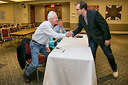 """Robert Ambrogi, left, shakes the hand of William Edward Palin at the """"Hackness to Justice 2014 Hackathon"""" session at the 2014 annual meeting of the American Bar Association in Boston at Suffolk University Law School.  photo by Kathy Anderson"""