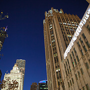 The historic Tribune Tower is a neo-Gothic structure located at 435 North Michigan Avenue, the heart of the Magnificent Mile. It is the home of the Chicago Tribune, Tribune Media, and tronc, Inc., formerly known as Tribune Publishing. WGN Radio (720 kHz) broadcasts from the building.The original Tribune Tower was built in 1868, but was destroyed in the Great Chicago Fire in 1871. Wrigley Building is on the left. Photography by Jose More