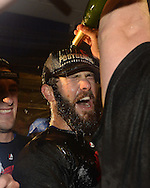 CHICAGO, IL - OCTOBER 12:  Jake Arrieta #49 of the Chicago Cubs celebrates in the clubhouse after Game 3 of the NLDS against the St. Louis Cardinals at Wrigley Field on Monday, October 12, 2015 in Chicago , Illinois. (Photo by Ron Vesely/MLB Photos via Getty Images) *** Local Caption *** Jake Arrieta