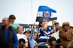 A Bath supporter in the crowd waves a flag - Mandatory byline: Patrick Khachfe/JMP - 07966 386802 - 05/10/2019 - RUGBY UNION - The Recreation Ground - Bath, England - Bath Rugby v Leicester Tigers - Premiership Rugby Cup