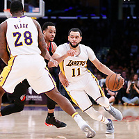 26 March 2016: Los Angeles Lakers guard Tyler Ennis (11) drives past Portland Trail Blazers guard CJ McCollum (3) on a screen set by Los Angeles Lakers center Tarik Black (28) during the Portland Trail Blazers 97-81 victory over the Los Angeles Lakers, at the Staples Center, Los Angeles, California, USA.