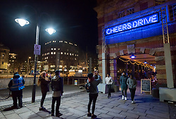 "© Licensed to London News Pictures. 27/02/2020. Bristol, UK. Bristol Light Festival; the artwork ""Overheard in Bristol"" at Bristol Harbourside, a four-metro neon sign featuring the famous Bristolian phrase ""Cheers Drive"". This is the launch of the first ever Bristol Light Festival, hosted by Bristol City Centre BID. Internationally renowned artists and local talent lighting up the city with a series of installations this weekend. Photo credit: Simon Chapman/LNP."