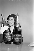 03/08/1962<br /> 08/03/1962<br /> 03 August 1962<br /> Champagne arrives for Horse Show Week Party. Two Lanson Black label Methusalahs (each equal to eight normal bottles) bottles of Champagne were specially flown from Reims, France for Mr Robert West Waffendan's Horse Show Week Party at the Candle Light Restaurant, Shangri-La Hotel, Dalkey, Dublin the next Monday night. Picture shows Hostess Ann Barrett, Aer Lingus, with the two bottles.