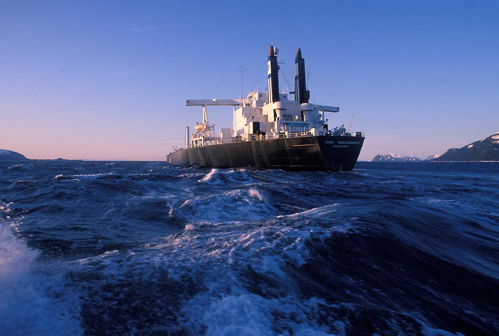 USA, Alaska, Oil tanker sails through Prince William Sound at dawn