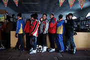 Chinese tourist queue at a ski resort in Harbin, China.
