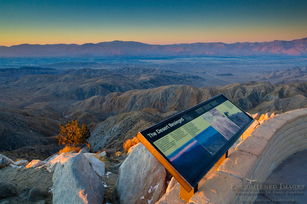 Interpretive sign at tourist overlook at sunrise, above the Coachella Valley, from Keys View, Joshua Tree National Park, California