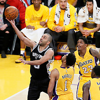 19 February 2016: San Antonio Spurs guard Tony Parker (9) goes for the layup past Los Angeles Lakers guard D'Angelo Russell (1), Los Angeles Lakers guard Louis Williams (23) and Los Angeles Lakers forward Brandon Bass (2) during the San Antonio Spurs 119-113 victory over the Los Angeles Lakers, at the Staples Center, Los Angeles, California, USA.
