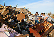 Greg Satterlee (R) shows his wife Genni where he thinks a file cabinet containing important papers may be in their tornado-destroyed home in Moore, Oklahoma May 21, 2013. A massive tornado tore through a suburb of Oklahoma City, wiping out whole blocks and killing at least 24.   REUTERS/Rick Wilking (UNITED STATES)