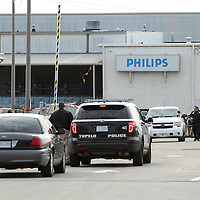 Adam Robison | BUY AT PHOTOS.DJOURNAL.COM<br /> Police investigators walk in the parking lot at Philips Day Brite during a bomb threat Friday morning in Tupelo.