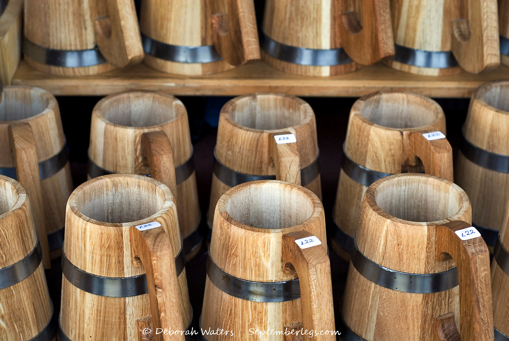 Hand crafted wooden tankard drinking cups for sale on a market stall at Tewkesbury Medieval Festival, Gloucester 2013