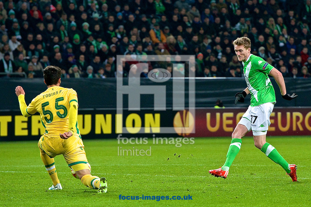 Tobias Figueiredo of Sporting Clube de Portugal (left) boocks the shot from Andre Sch&uuml;rrle of VfL Wolfsburg during the UEFA Europa League match at Volkswagen Arena, Wolfsburg<br /> Picture by Ian Wadkins/Focus Images Ltd +44 7877 568959<br /> 19/02/2015