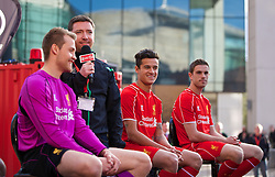 LIVERPOOL, ENGLAND - Thursday, April 10, 2014: Liverpool's goalkeeper Simon Mignolet, Philippe Coutinho Correia and Jordan Henderson at the launch of the new Warrior home kit for 2014/2015 at the Liverpool One shopping centre. (Pic by David Rawcliffe/Propaganda)